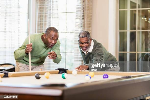 two african-american men playing billiards - old men playing pool stock pictures, royalty-free photos & images