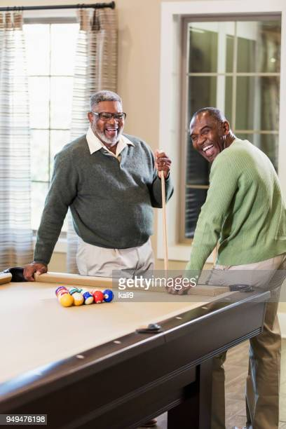 two african-american men shooting pool - old men playing pool stock pictures, royalty-free photos & images