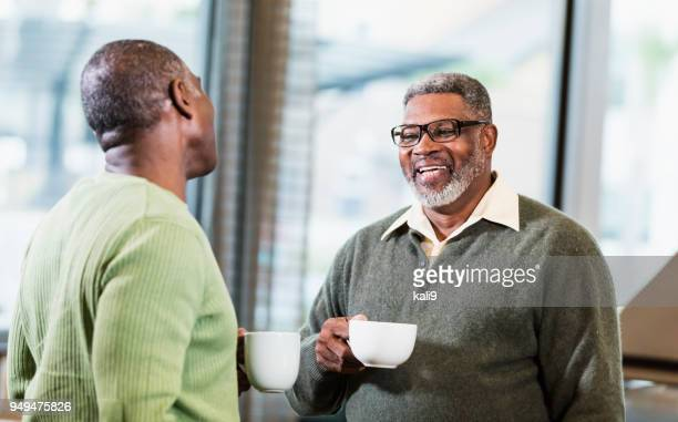 Two African-American men talking over coffee