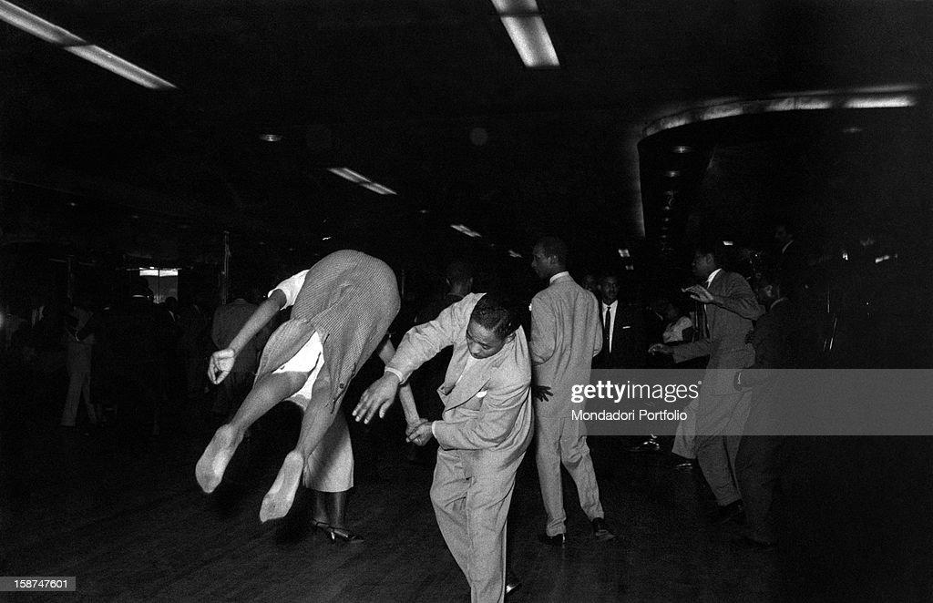 Two African-American people dancing rock  n roll in a nightclub. New ... 9252c7f1c472