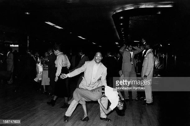 Two AfricanAmerican people dancing rock 'n roll in a nightclub New York April 1959