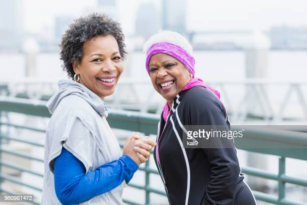 Two African-American woman walking in city