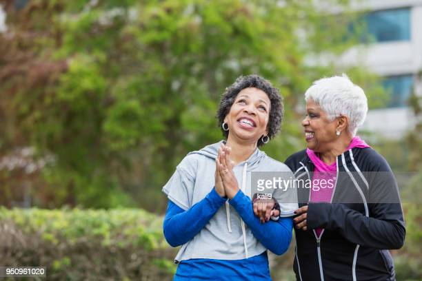 two african-american women laughing together, praying - place of worship stock pictures, royalty-free photos & images