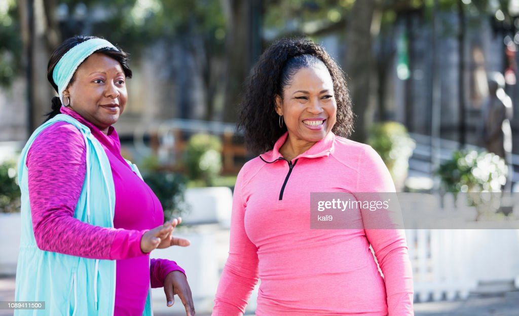 Two African-American women standing outdoors : Stock Photo