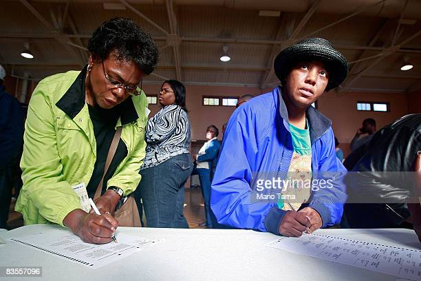 Two AfricanAmericans women vote in a recreation center in the presidential election November 4 2008 in Birmingham Alabama Birmingham along with Selma...