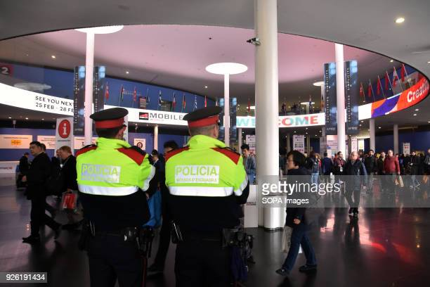 Two agents of the Catalan Police guard access to the Mobile World Congress The Mobile World Congress 2018 is being hosted in Barcelona from 26...