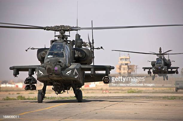 Two AH-64 Apache helicopters return from a mission over Northern Iraq during Operation Iraqi Freedom.