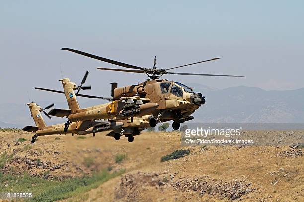 Two AH-64A Peten attack helicopters of the Israeli Air Force in flight over the Golan Heights, Israel.