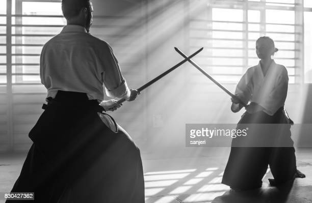 Two Aikido Fighters With Bokken Swords