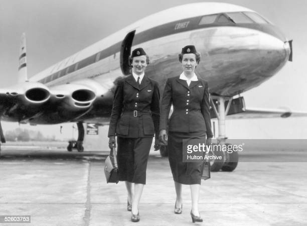 Two air hostesses walking away from a BOAC Comet circa 1950