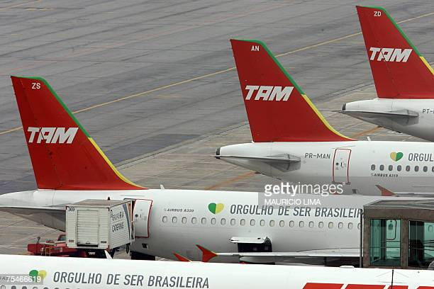 Two Airbus A320 and two Airbus A319 are parked at a terminal of Sao Paulo's airport in Brazil on July 18th 2007 On Tuesday a Tam Airlines Airbus 320...