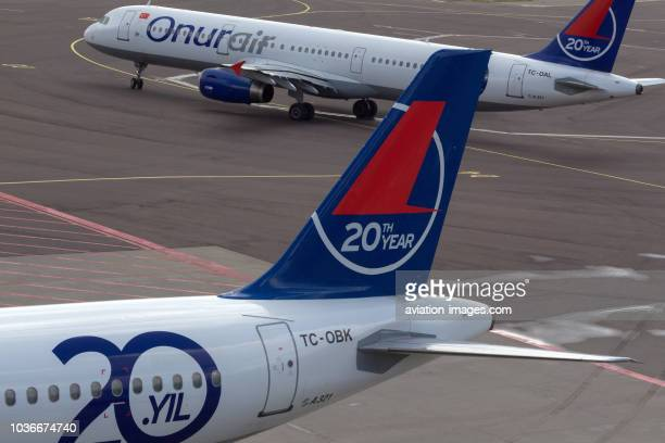 Two Airbus A321 civil jet airplanes of Onur Air at Schiphol airport Amsterdam Netherlands