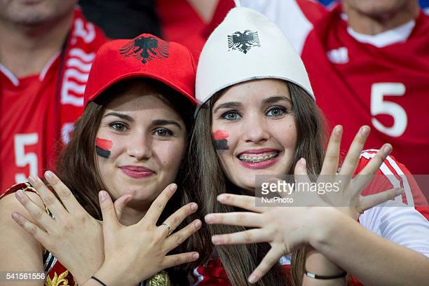 Two Albanian fans celebrate during the UEFA Euro 2016 Group A match between Romania and Albania at Stade de Lyon in Lyon France on June 19 2016