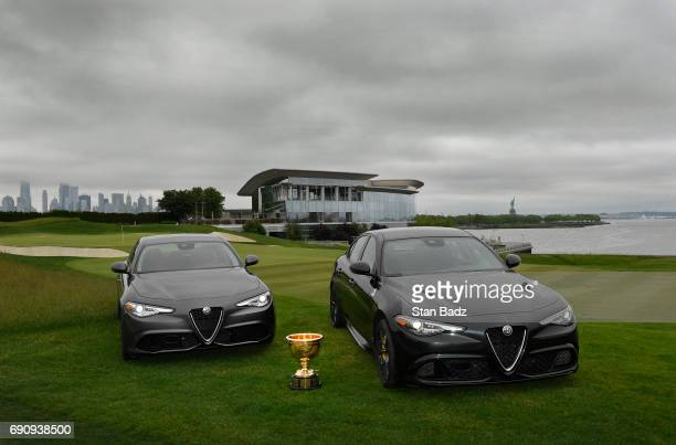 Two Alfa Romeo Giulia vehicles are displayed before the Presidents Cup announcement of Alfa Romeo as the 3rd Global Partner at Liberty National Golf...