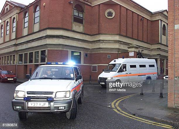 Two Algerian Men Accused Of Being Members Of Osama Bin Laden's Al Qaeda Terrorist Network Are Driven From Court By British Police January 17 2002 In...