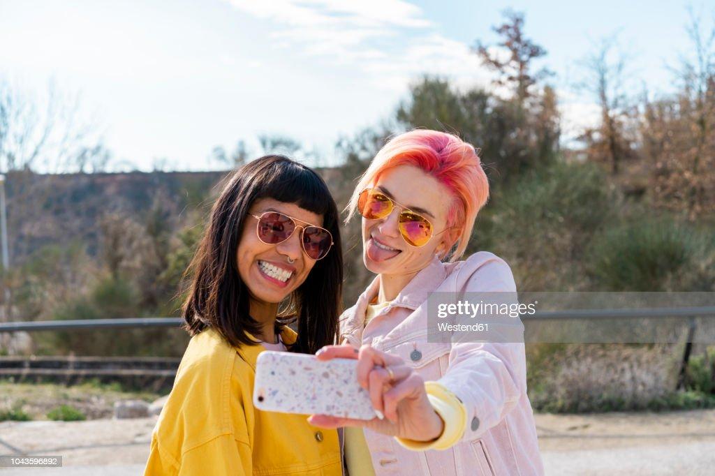 Two alternative friends taking selfie : Stock Photo