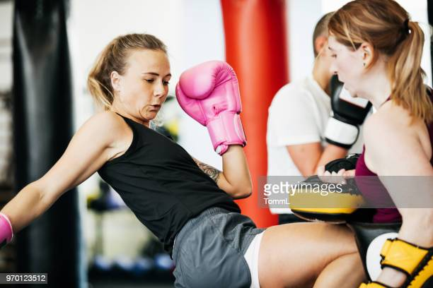 Two Amateur Kickboxers Sparring Together