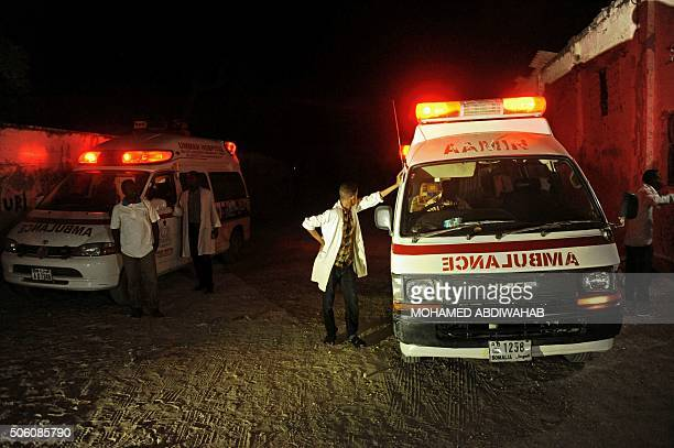 Two ambulances stand on the scene of a bomb attack on January 21 2016 at Lido Beach in Mogadishu A car bomb exploded at a popular seaside restaurant...