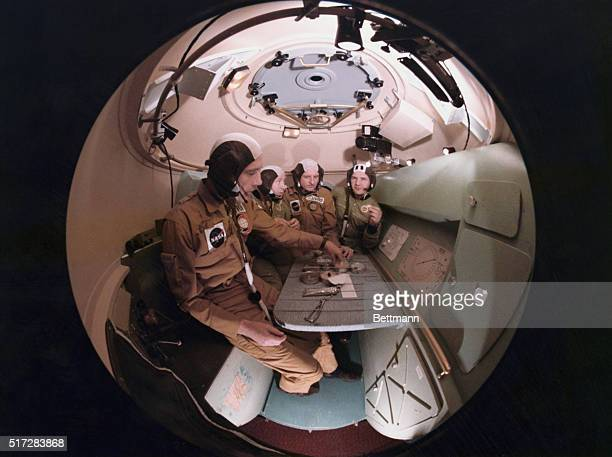 Two American ASTP prime crewmen have a meal with the Soviet ASTP first crewmen during ApolloSoyuz Test Project joint crew training at the Johnson...
