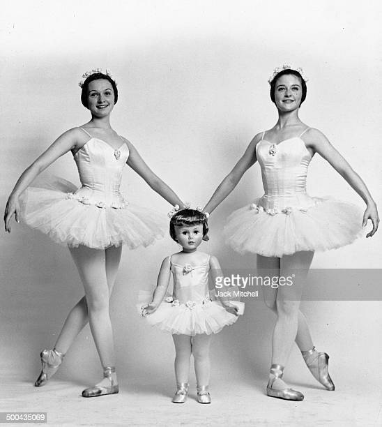 Two American Ballet Theatre ballerinas with a doll the company presented to Caroline Kennedy May 22 1962