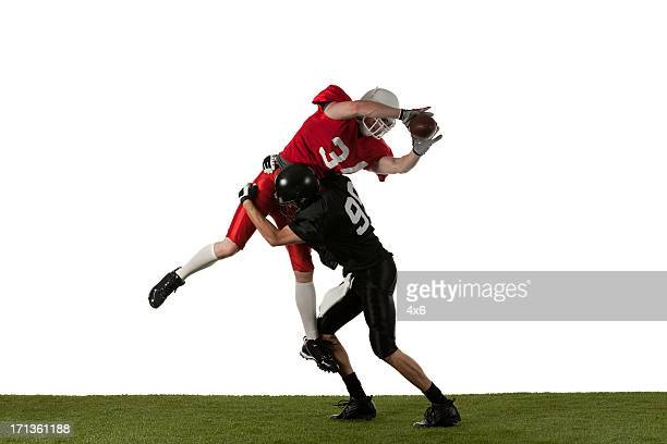two american football players in action - tackling stock pictures, royalty-free photos & images