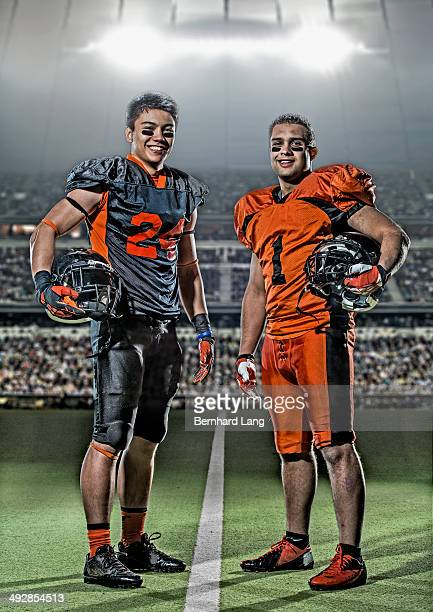 two american football players in stadium - eye black stock photos and pictures
