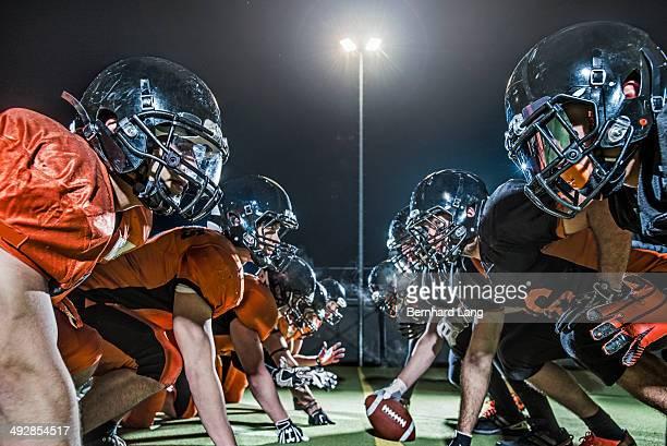 two american footballers teams head to head - football stock-fotos und bilder