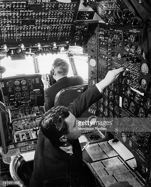 Two American pilots in the cockpit of a transoceanic aircraft of the American air company 'Pan American World Airways' USA 1950s