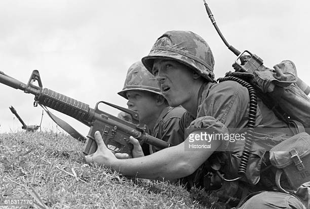 Two American soldiers take cover from Viet Cong fire Vietnam 1967