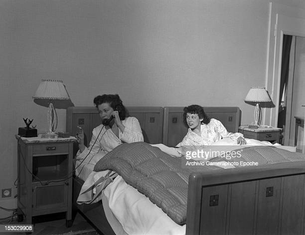 Two American young women calling the room service in Lausanne 4th January 1949