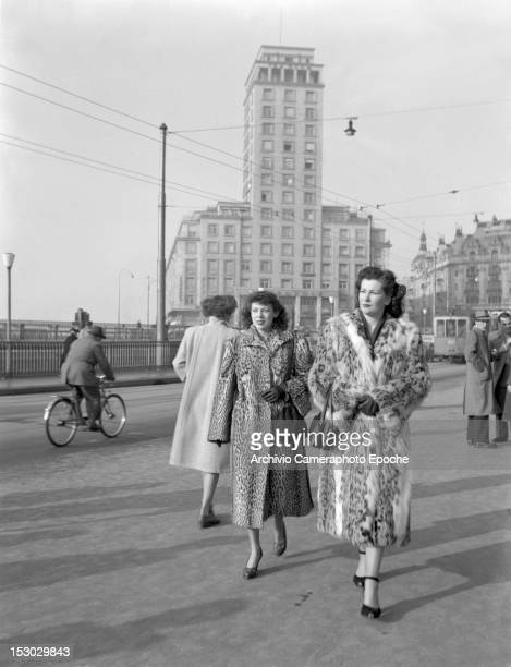 Two American young women wearing furs having a walk in Lausanne 4th January 1949