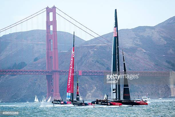 two america's cup teams out training - catamaran race stock photos and pictures