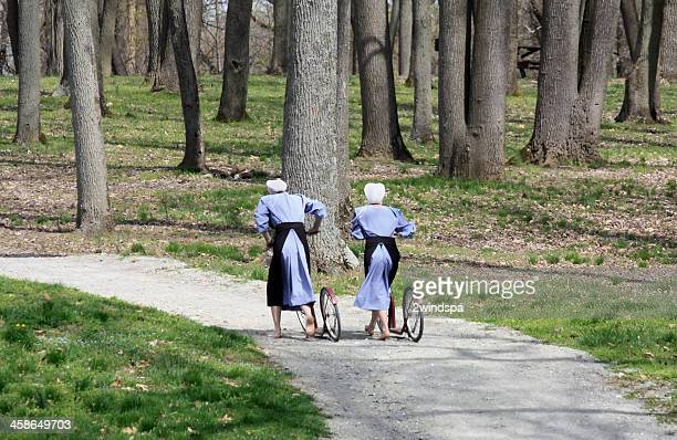 two amish girls in blue - amish woman stock pictures, royalty-free photos & images
