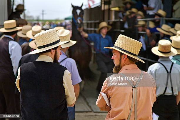 CONTENT] Two Amish men at a livestock auction at the Rawlinsville Amish Mud Sale in Lancaster County Pennsylvania Rural Pennsylvania Dutch