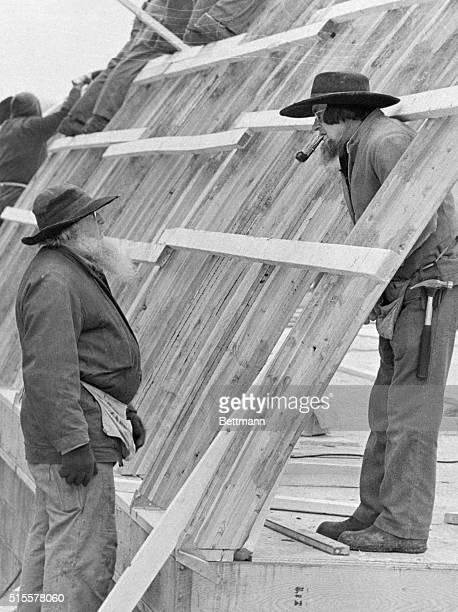 Two Amish men confer during a barn raising in New Wilmington Pennsylvania The barn was erected in one day December 18 1973 | Location New Wilmington...