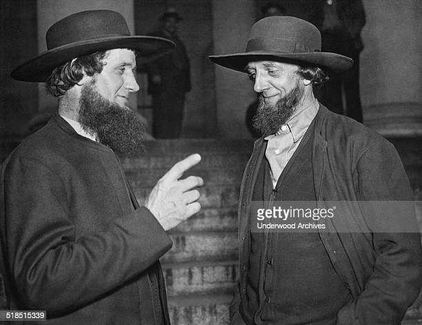 Two Amish men in Washington DC to protest the Public Works Administration {PWA} grant to build schools in their district as it would violate tenets...