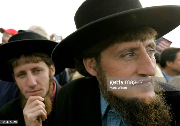 Two Amish men listen to US President George W Bush speak to supporters during a campaign rally at Lancaster Airport October 27 2004 in Lancaster...