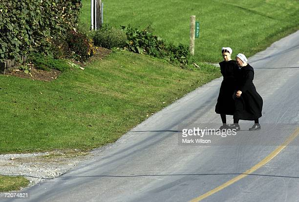 Two Amish women walk to the home of one of the girls that was killed yesterday at the one room Amish schoolhouse shooting October 3 2006 in Nickel...