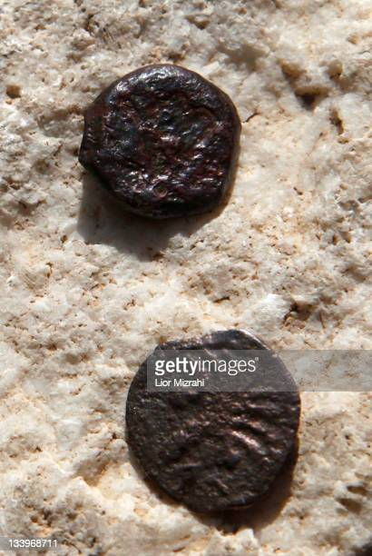 Two ancient bronze coins which according to Israel Antiquities Authority archaeologists were struck by the Roman procurator of Judea Valerius Gratus...