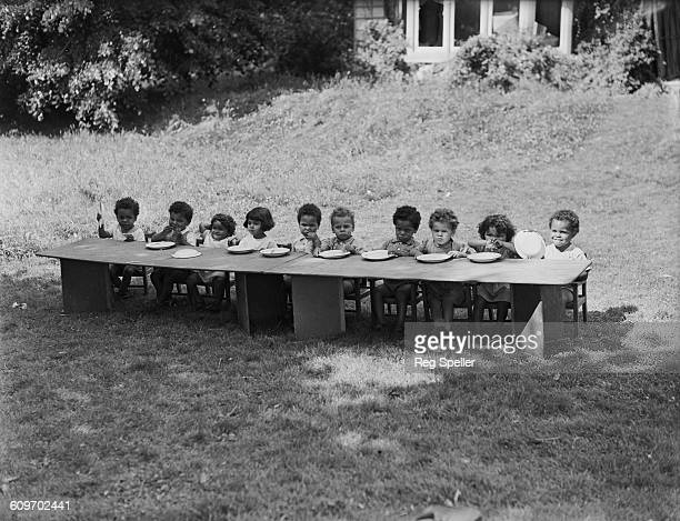 Two and three yearold children ready for an outdoor meal at the Holnicote children's home run by Somerset County Council on the Holnicote Estate in...