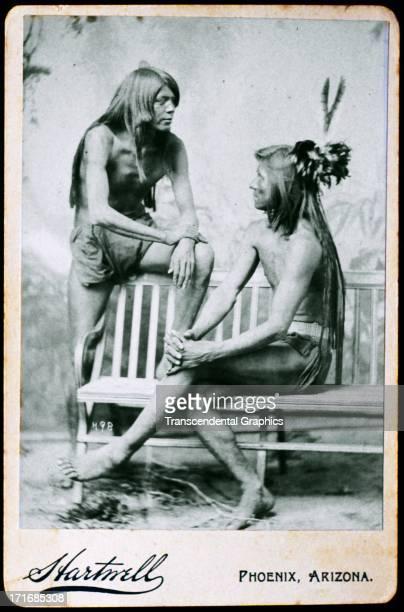 Two Apache braves pose in a studio circa 1885 in Phoenix Arizona