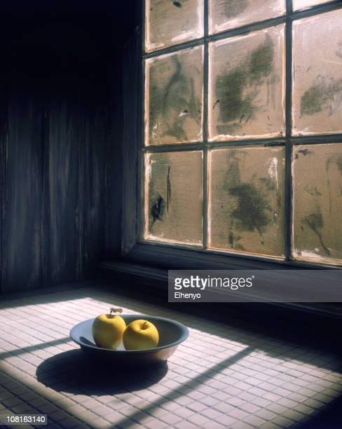 Two Apples in Bowl by Frosty Window
