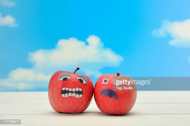 Two apples with the face