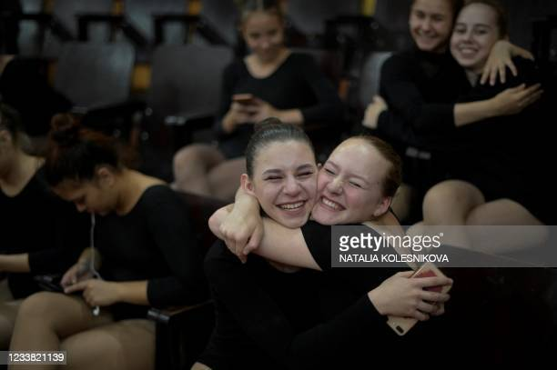 Two applicants react during their admission exam at the circus college in Moscow, on July 5, 2021. - The State College for Circus and Variety Arts...