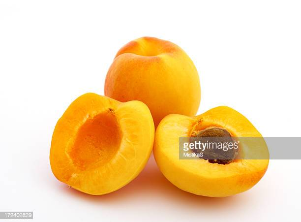 Two apricots one sliced one whole