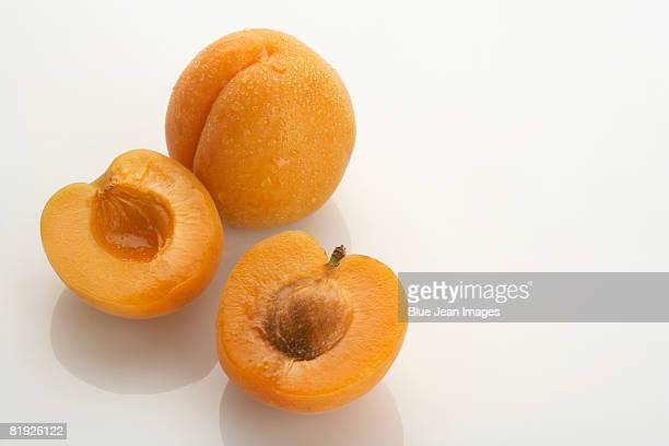 Two apricots, one split in half