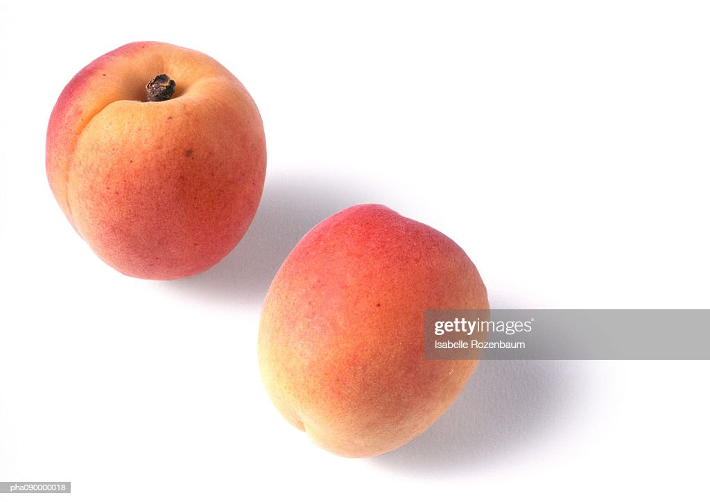 Two apricots, white background : Stock-Foto