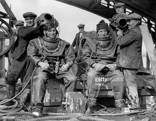 Two aquanauts father and son doing some underwater repair work at the new Richmond railway bridge Photograph 22nd of February 1934 Photo by Austrian...