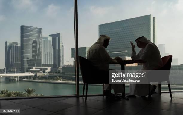 Two arab men in a futuristic city