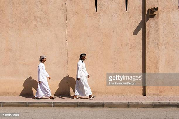 Two Arab men in traditional clothing